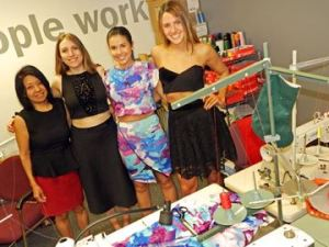 Local fashion designer, Carmina De Young has joined with London-based fashion enterprise Ezzy Lynn — including co-founders (from left) Samantha Laliberte, Sonja Fernandes and Bianca Lopes — in a new partnership with Goodwill's Pivotal manufacturing services to produce and distribute new lines of clothing that build upon the company's commitment to socially conscious business practices.
